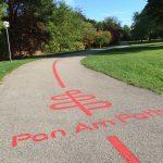 Pan Am Path logo on paved trail