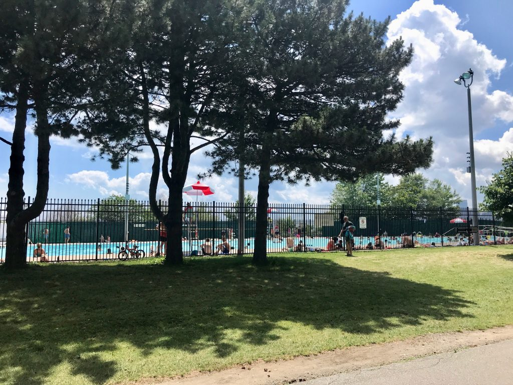 Cycling past the Sunnyside Park pool.