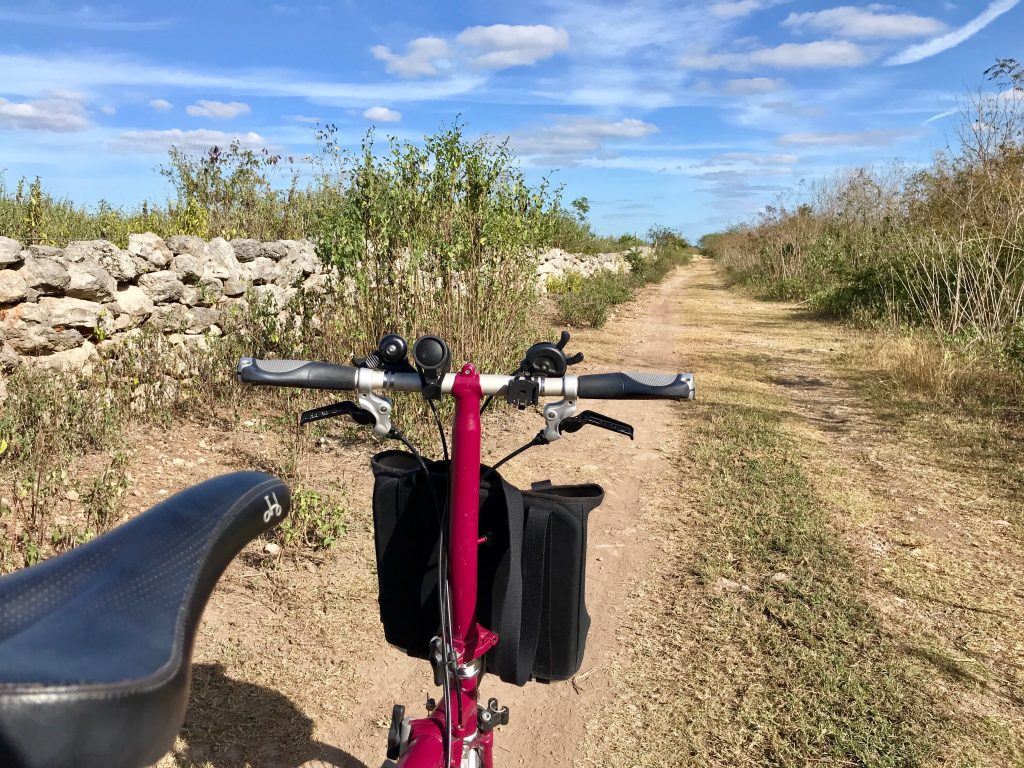 Brompton on dirt road leading out of Aké, Mexico.