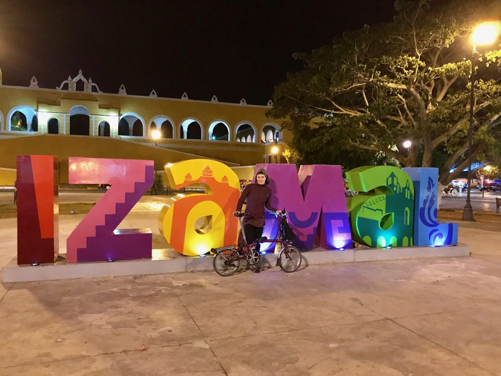 Brompton in front of the Izamal sign.