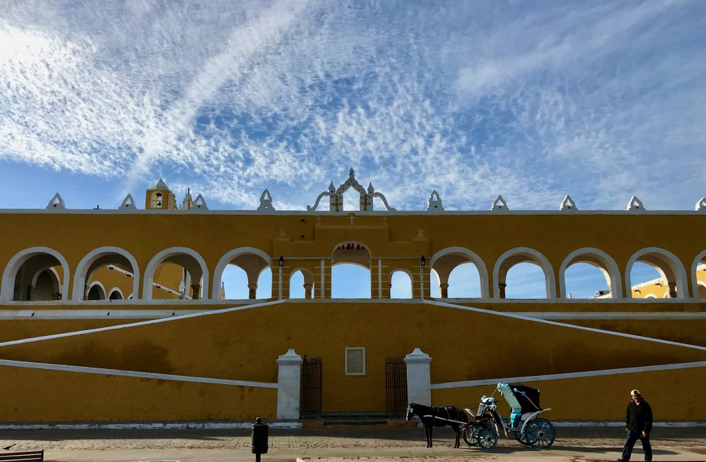 Horse carriages gather on the north exterior side of Convento square, Izamal, Mexico.