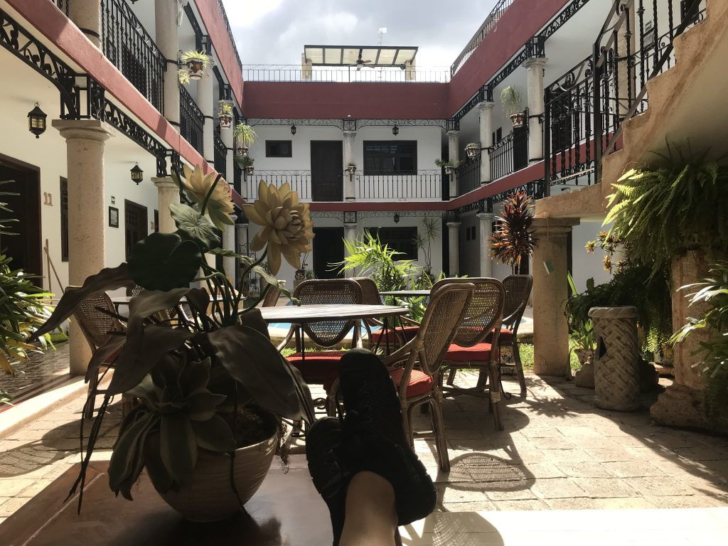 Hanging out in the courtyard by the pool. Hotel Colonial La Aurora, Valladolid, Mexico.
