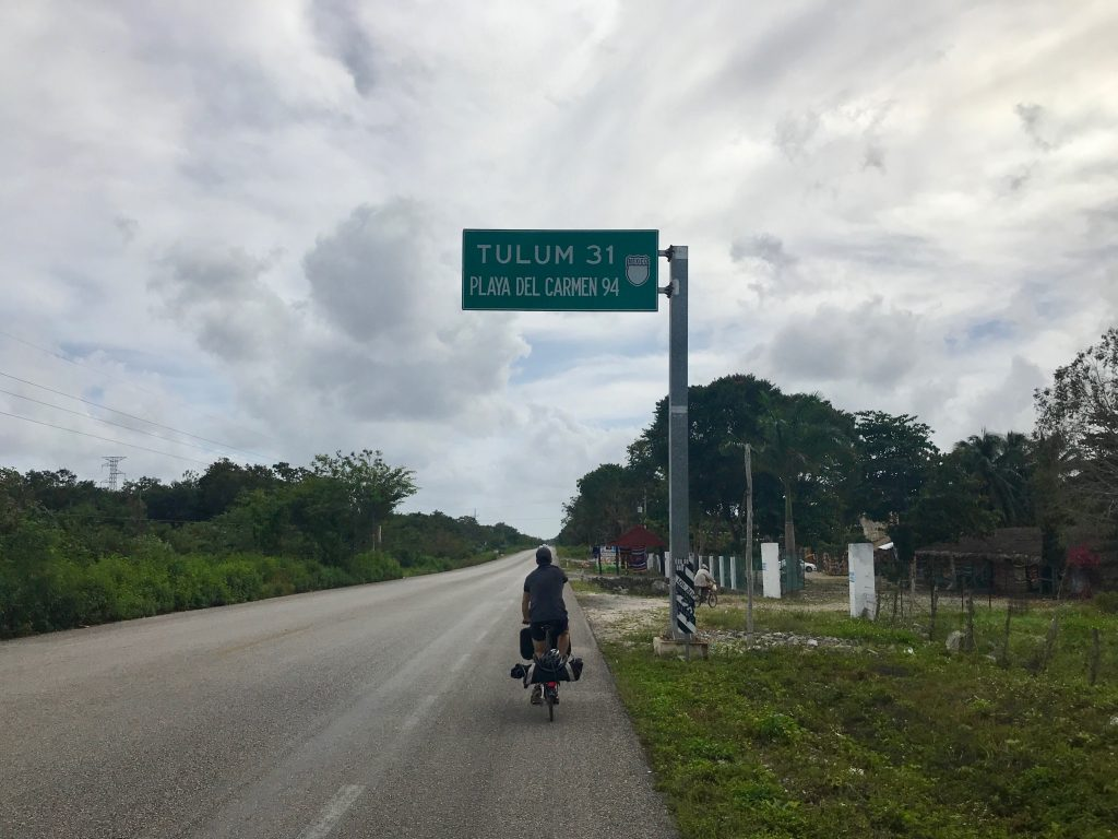 Cycling on the highway to Tulum.