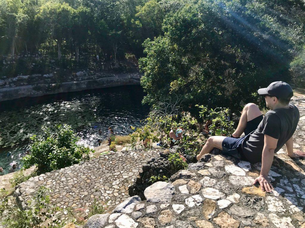 Ruin overlooking cenote in Dzibilchaltun, Mexico.