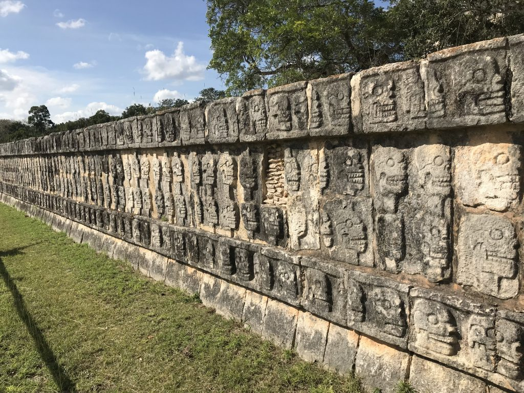 A whole wall of skull carvings! Chichen Itza, Mexico