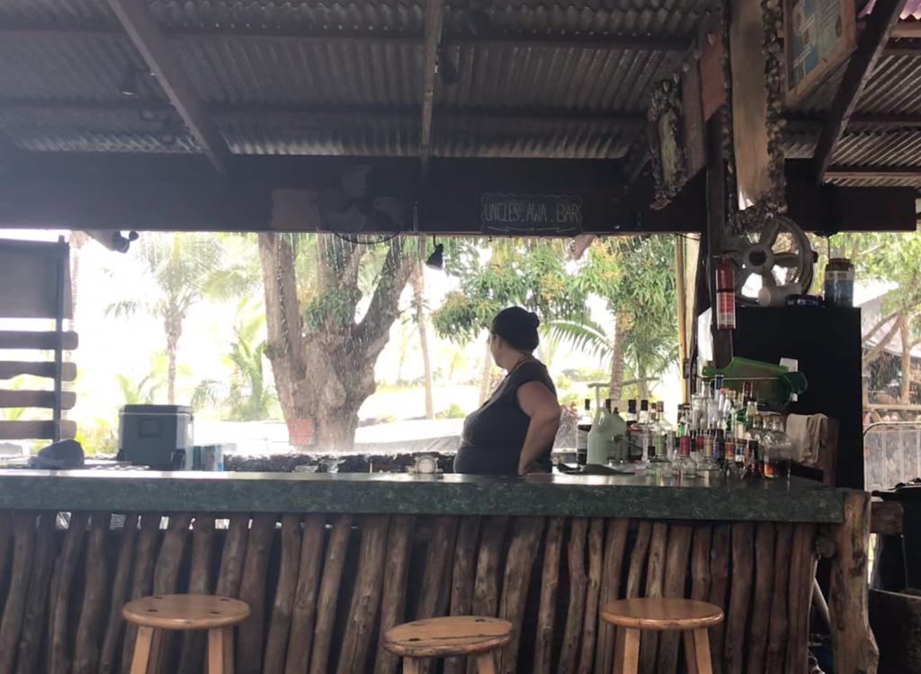 Waiting for the rain to stop by Uncle Robert's Awa Bar, Kaimu Beach, Puna, Hawaii.