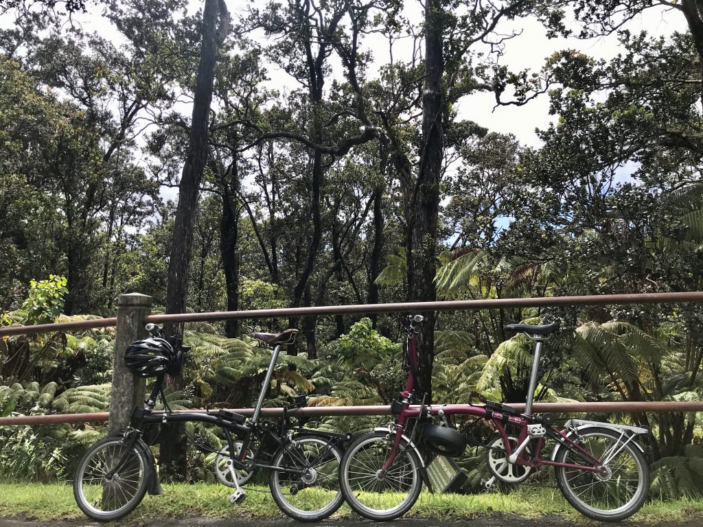 Bromptons parked to metal railing, Volcanoes National Park, The Big Island, Hawaii.