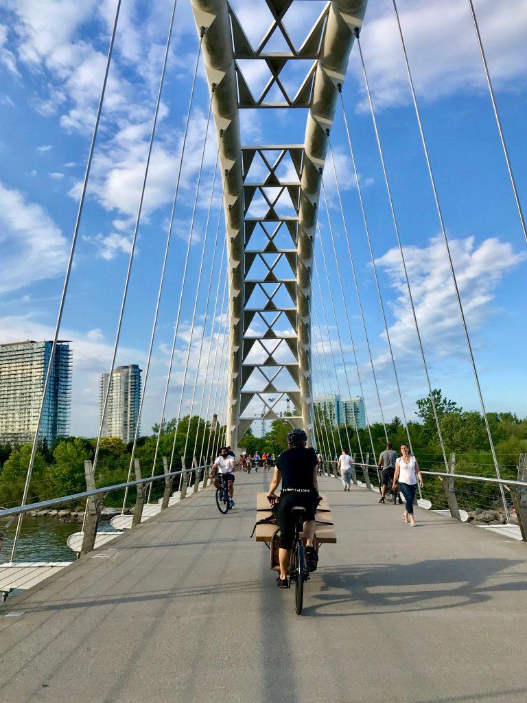 Loaded cargo bike on the Humber Bay Arch Bridge. Toronto, Canada