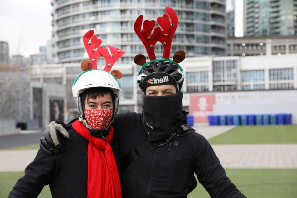 Heather and Pier as Santa's cycling reindeer.